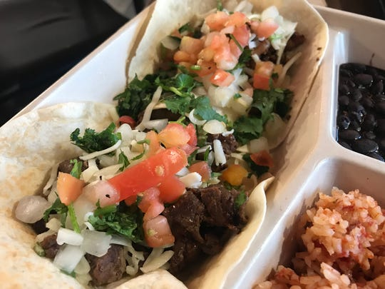 The two taco plate at Chronic Tacos is served with rice and beans.