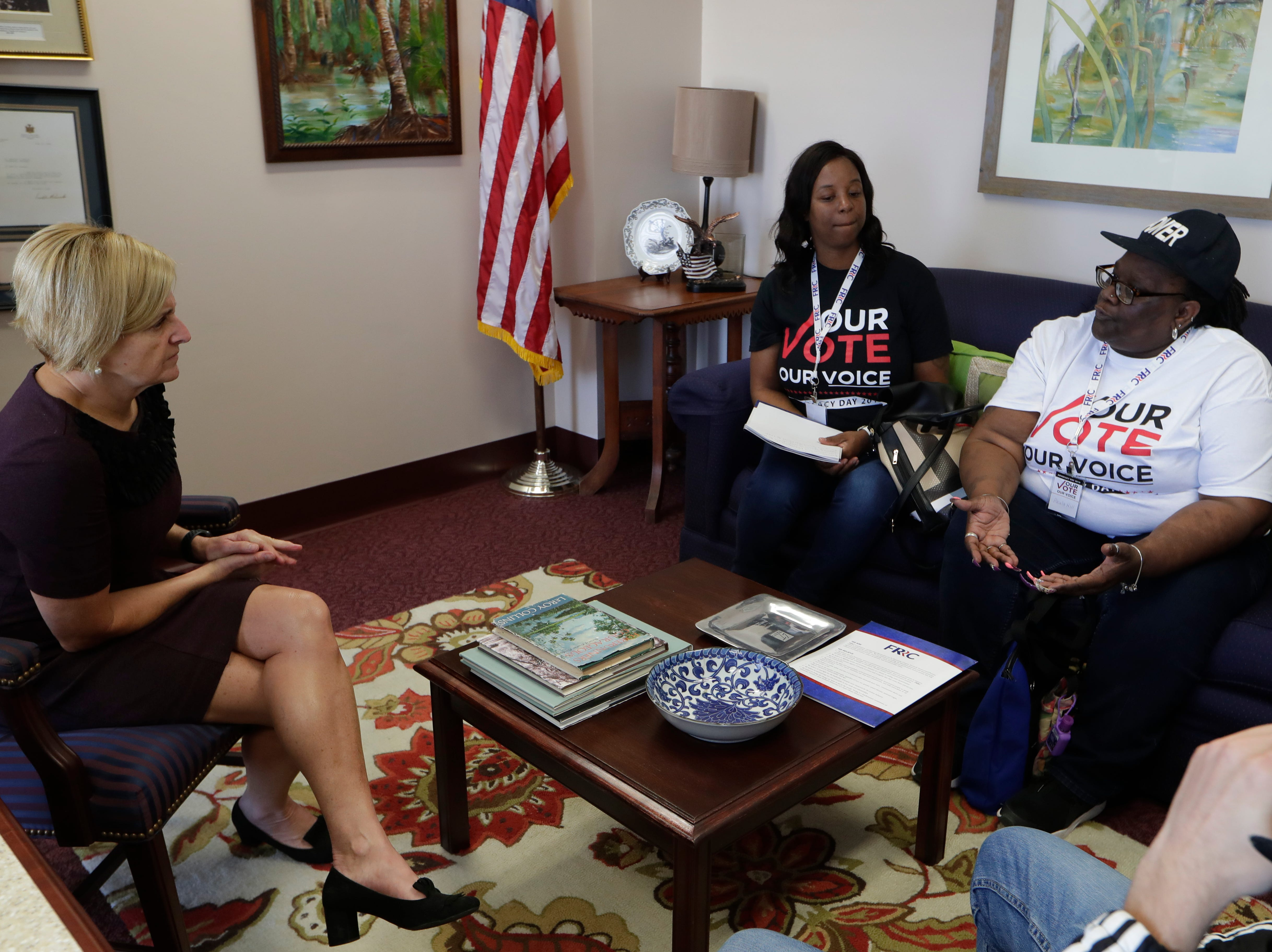 Latisha Berry, left, and Paula Hill, both of Tallahassee, talk with Rep. Loranne Ausley in her office Tuesday as over 500 Floridians with felony convictions whose voting rights were restored in November met with representatives at the Capitol during an Amendment 4 returning citizens advocacy day organized by the Florida Rights Restoration Coalition.