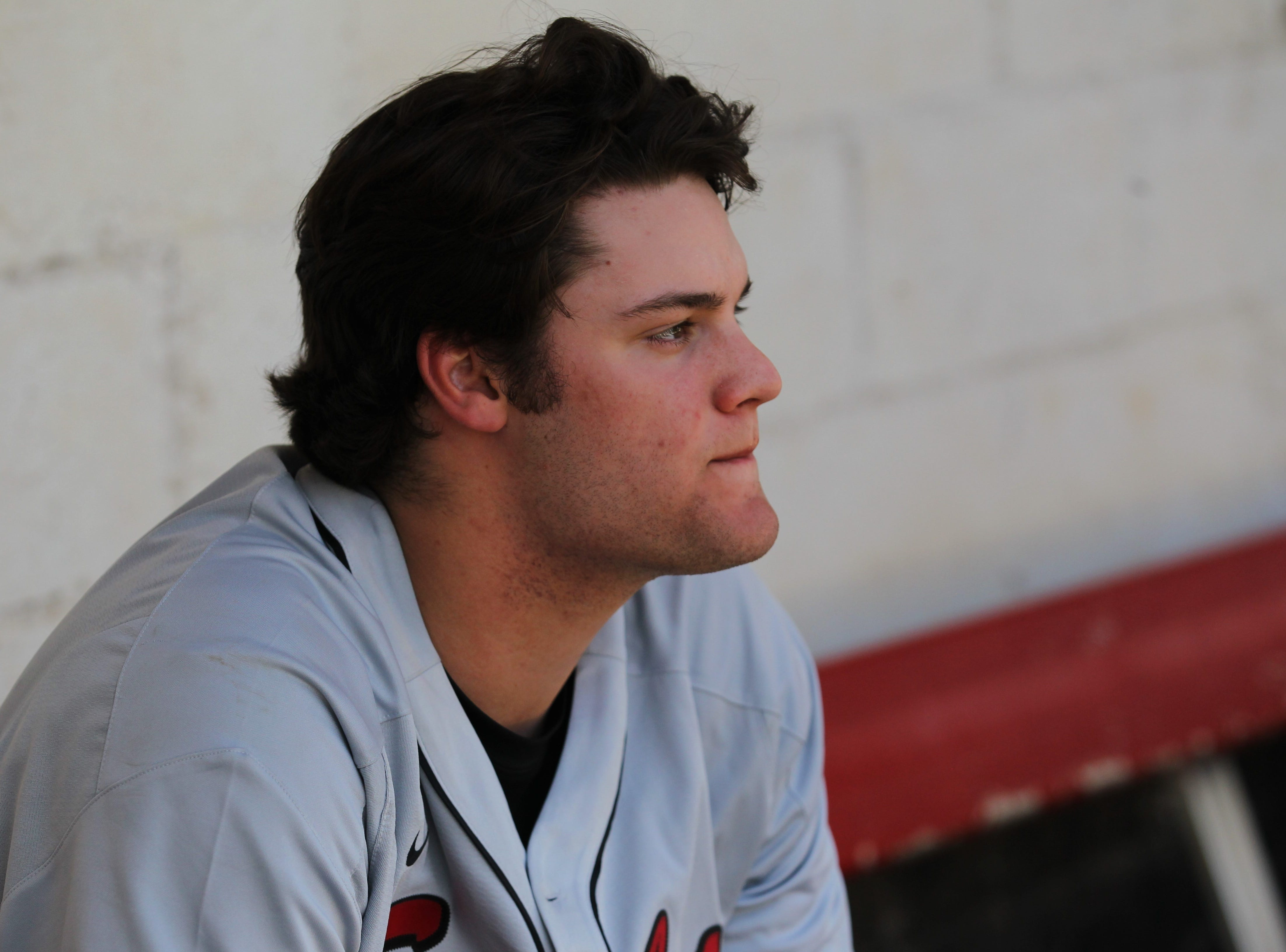 NFC senior pitcher Major Posey watches from the dugout as NFC plays at Leon during a preseason game in February.