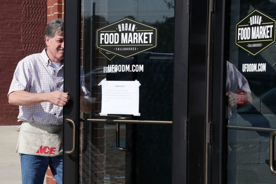 Jamie Burch with Lockmobile changes the locks on the doors of Urban Food Market Tuesday, March 12, 2019. Signs are posted on all of the doors saying the business was closed as of March, 11, 2019 and will not reopen until later in spring but the owner does not expect to reopen until Oct. 2019.