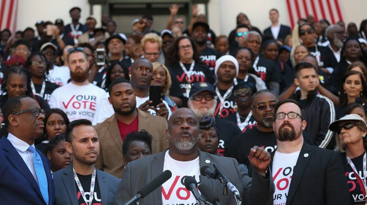 Dezmond Meade, Florida Rights Restoration Coalition president, speaks in front of 500 Floridians with felony convictions whose voting rights were restored in November, as they gathered in the courtyard of the Capitol Tuesday before meeting with legislators to advocate for Amendment 4 legislation.