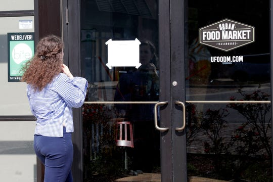 Abby Wright walks up to Urban Food Market and reads a sign posted on the door stating the market had closed as of March 11, 2019 and will not reopen until later in spring. The owner says he does not expect to reopen until Oct. 2019.