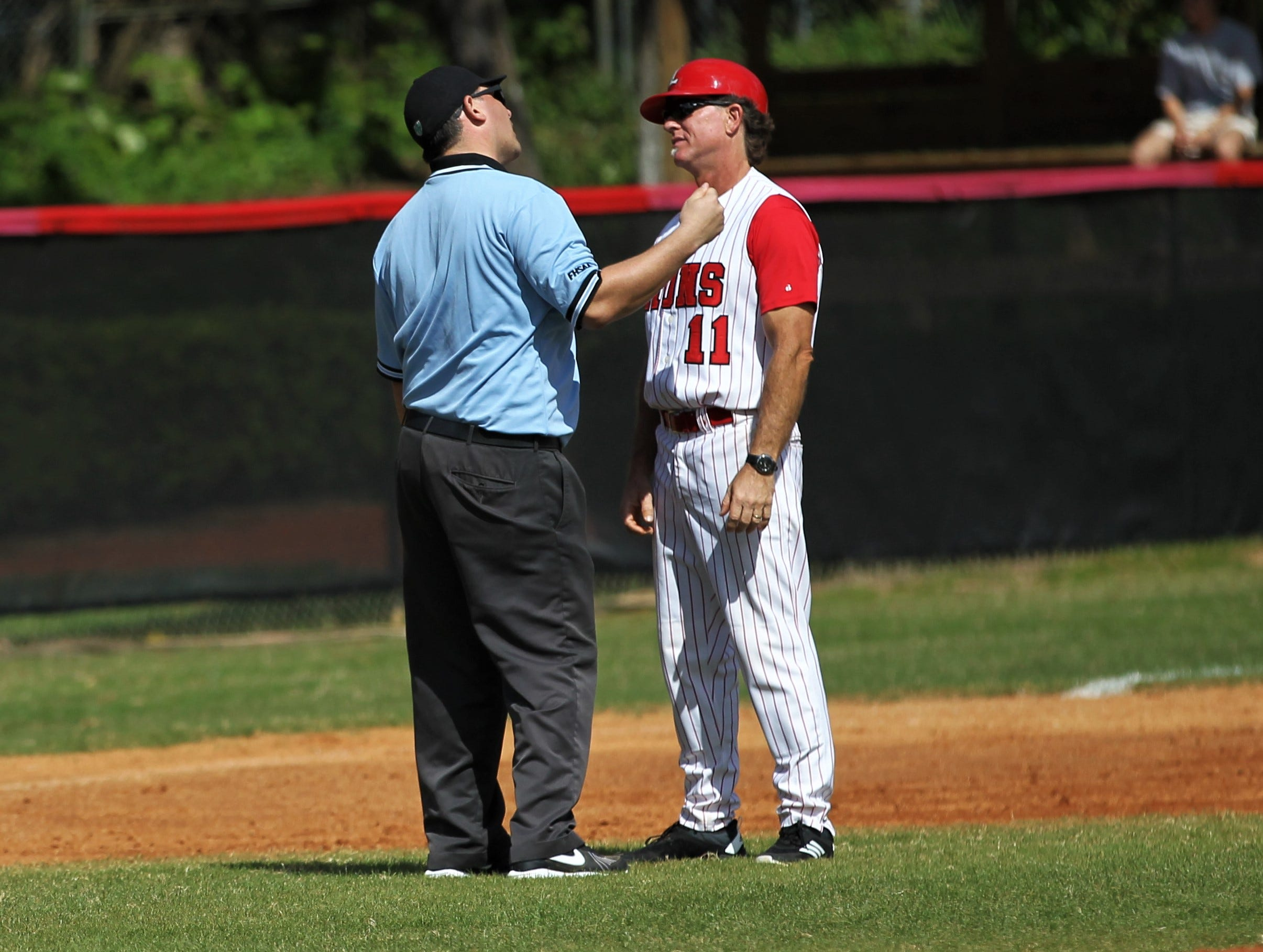 Leon baseball coach Robbie Zimmerman questions a call as NFC plays at Leon during a preseason game in February.
