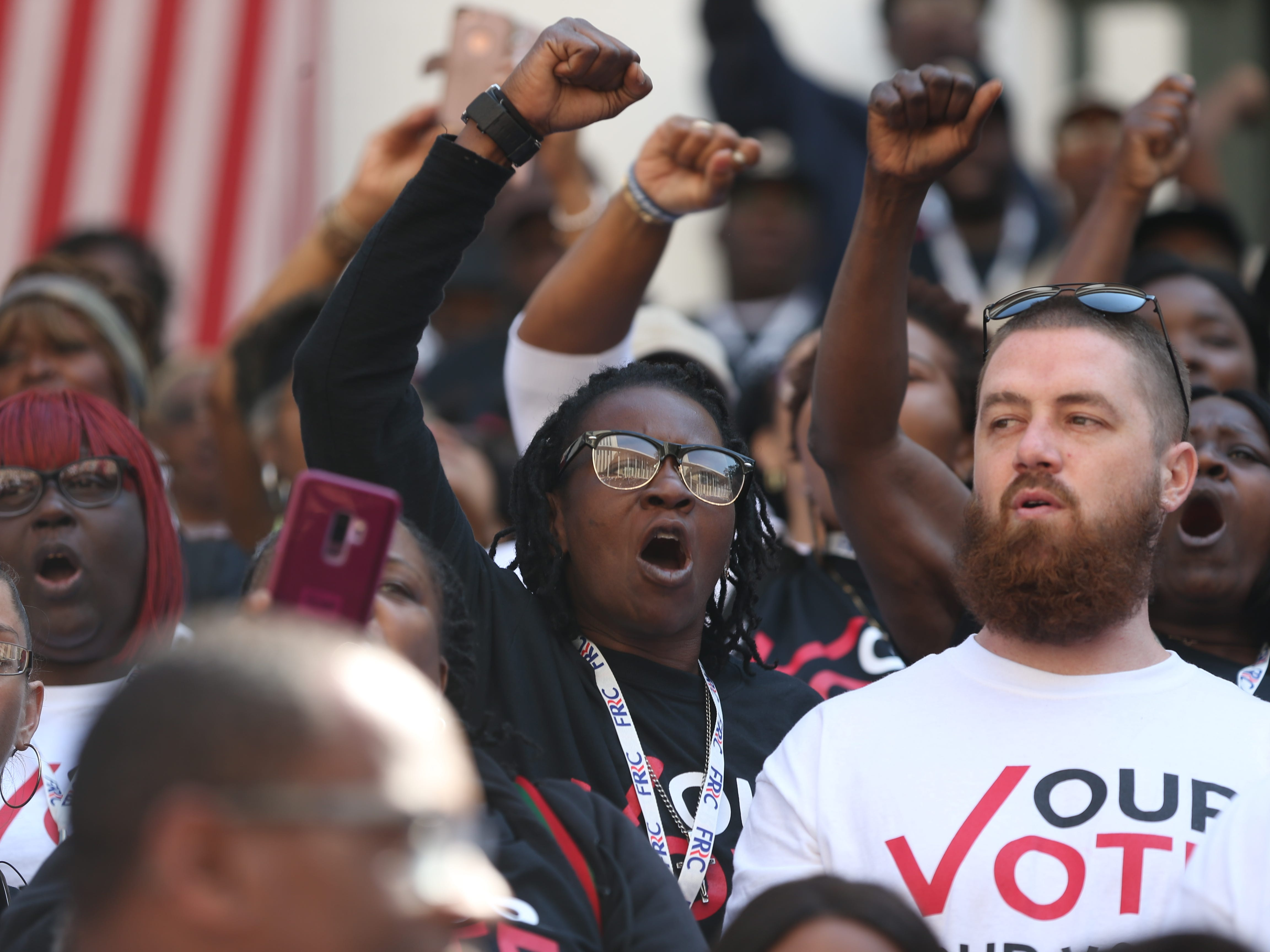 Five hundred Florida residents convicted of felonies whose voting rights were restored by vote in November, gathered in the courtyard of the Florida State Capitol Tuesday to rally before meeting with legislators to advocate for Amendment 4 legislation.