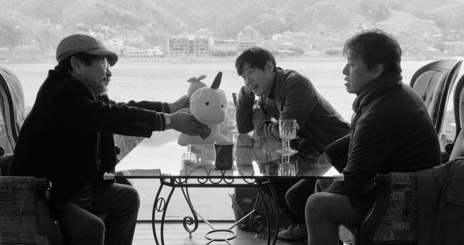 """Convinced he's on the verge of death, an aging poet (Ki Joobong) invites his two bickering sons (Yu Junsang and Kwon Haehyo) to an isolated hotel for a final goodbye in """"Hotel By The River."""""""