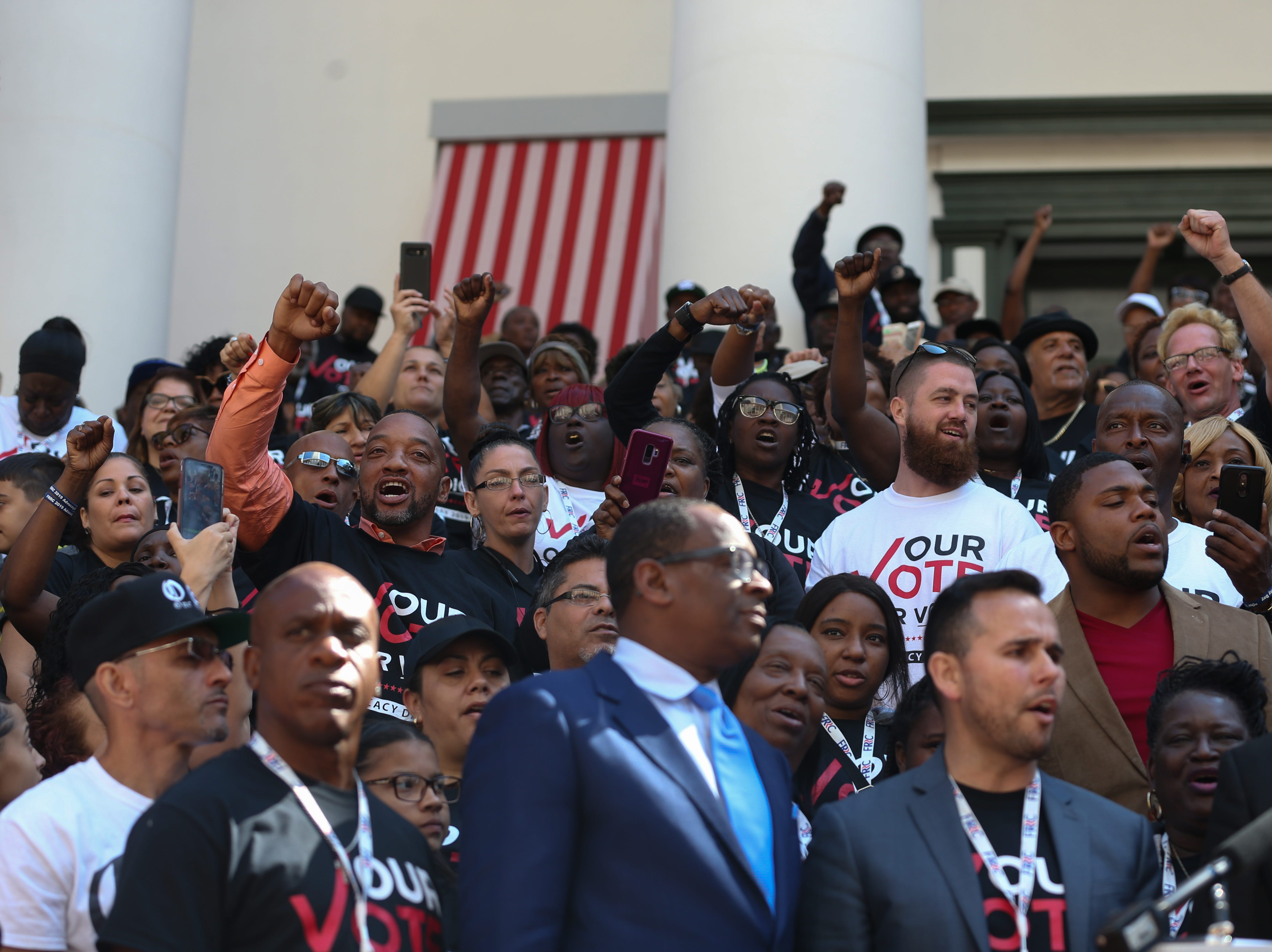 Five hundred Floridians with felony convictions whose voting rights were restored by vote in November, gathered in the courtyard of the Florida State Capitol Tuesday to rally before meeting with legislators to advocate for Amendment 4 legislation.