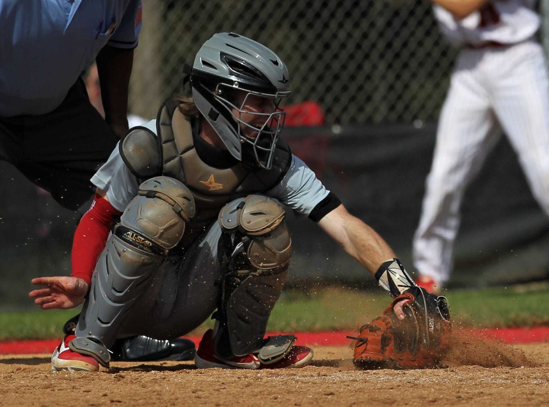 NFC catcher Carson Neal digs a pitch out of the dirt as NFC plays at Leon during a preseason game in February.