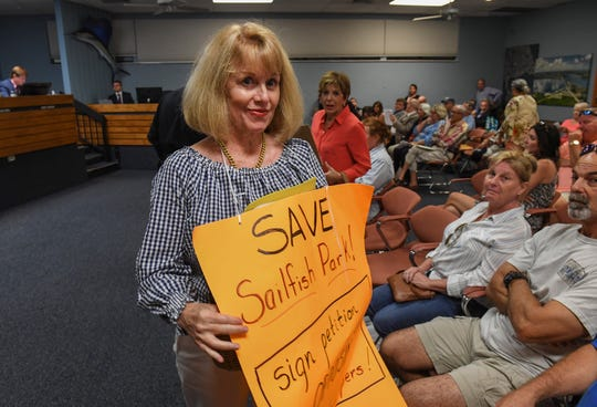 "Stuart resident Linda Shayne (center) exits the City Commission chambers after the commission unanimously voted not to redevelop Sailfish Park during its regular meeting on Monday, March 11, 2019, at Stuart City Commission Chambers, at 121 S.W. Flagler Ave. ""We're thrilled; it's a win for the baseball players and a win for the the community of Stuart,"" Shayne said. ""They voted to keep it as a park and a green space."""