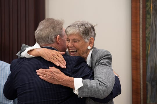 Martin County environmentalist and former commissioner Maggy Hurchalla embraces longtime friend John Milledge, of Fort Lauderdale ahead of a hearing Tuesday, March 12, 2019, where Hurchalla appealed a Martin County jury's decision that she owes $4.4 million to rock quarry Lake Point for interfering in their contract with the county and the South Florida Water Management District at the Fourth District Court of Appeal in West Palm Beach. Supporters of Hurchalla filled the courtroom as both sides made their case to three judges.