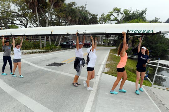 Female junior members of Vero Beach Rowing cross the street to the boat ramp on Tuesday, March 12, 2019, for the afternoon practice at MacWilliam Park in Vero Beach. Currently, the club has about 30 youth members, but the club would like to increase that membership to 60, according to rowing coach Brian Colgan. The club has also been granted permission to start a $2.5 million construction project on a new boathouse.
