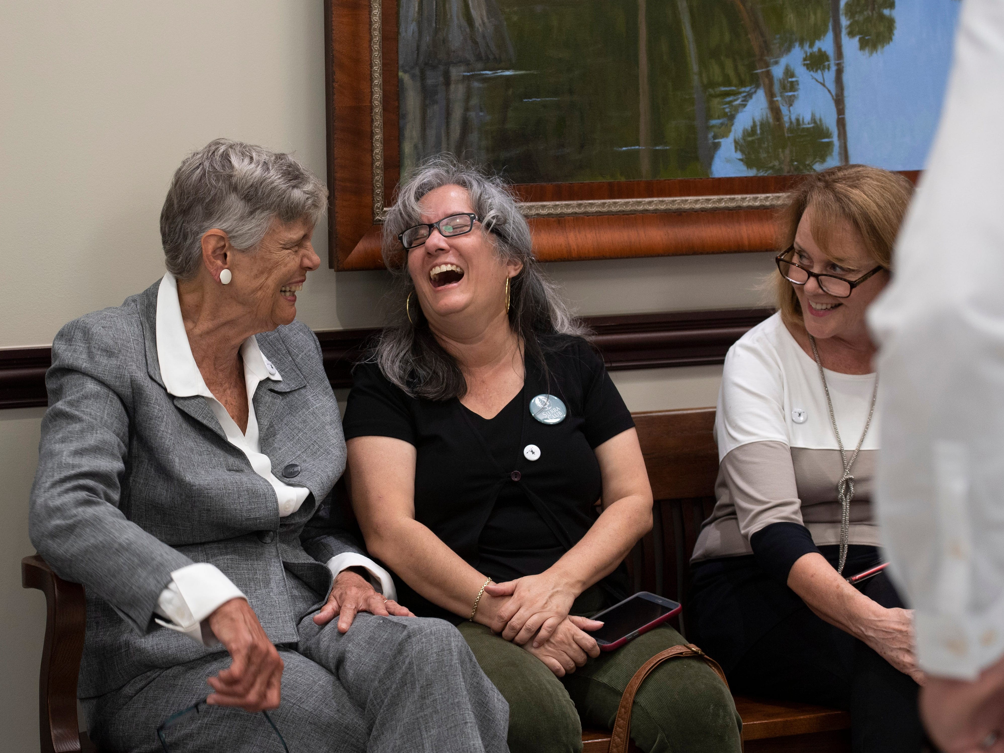 Supporters of Martin County environmentalist and former commissioner Maggy Hurchalla filled the lobby of the Fourth District Court of Appeal ahead of a hearing where Hurchalla appealed a Martin County jury's decision that she owes $4.4 million to rock quarry Lake Point for interfering in their contract with the county and the South Florida Water Management District on Tuesday, March 12, 2019, at the courthouse in West Palm Beach.