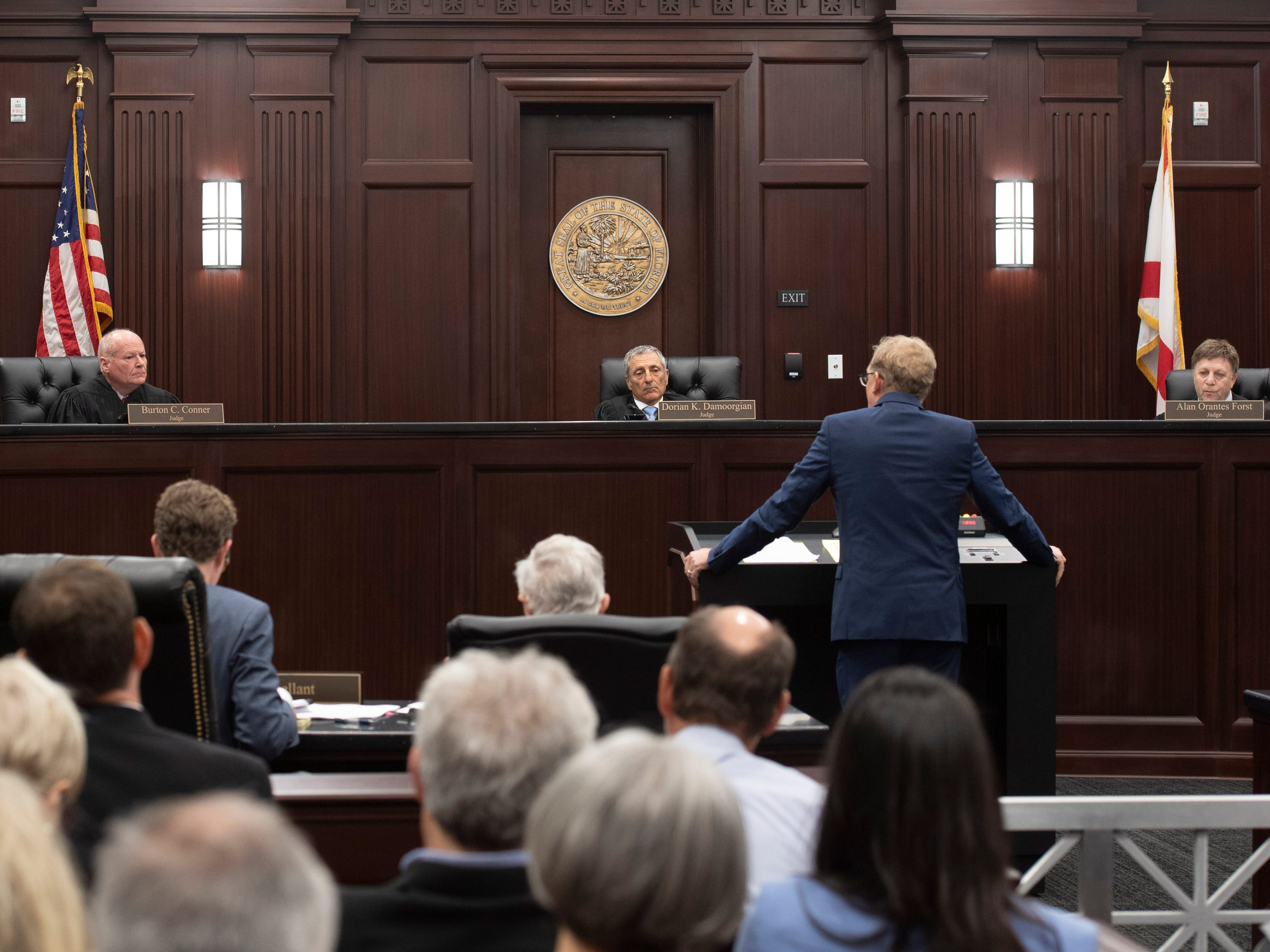 Lake Point attorney Jon Tasso addresses Fourth District Court of Appeal judges (from left) Burton C. Conner, Dorian K. Damoorgian and Alan O. Forst during Martin County environmentalist and former commissioner Maggy Hurchalla's appeal of a jury's decision that she owes $4.4 million to Lake Point, a rock quarry in western Martin County, during a hearing Tuesday, March 12, 2019, at the courthouse in West Palm Beach.