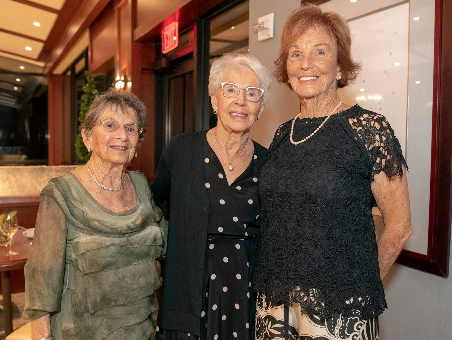Mary Kay Buckridge, left, Helen Blake and Claudette Mitchell at the 2019 Frances Langford Humanitarian Award reception at Sailfish Point Country Club.