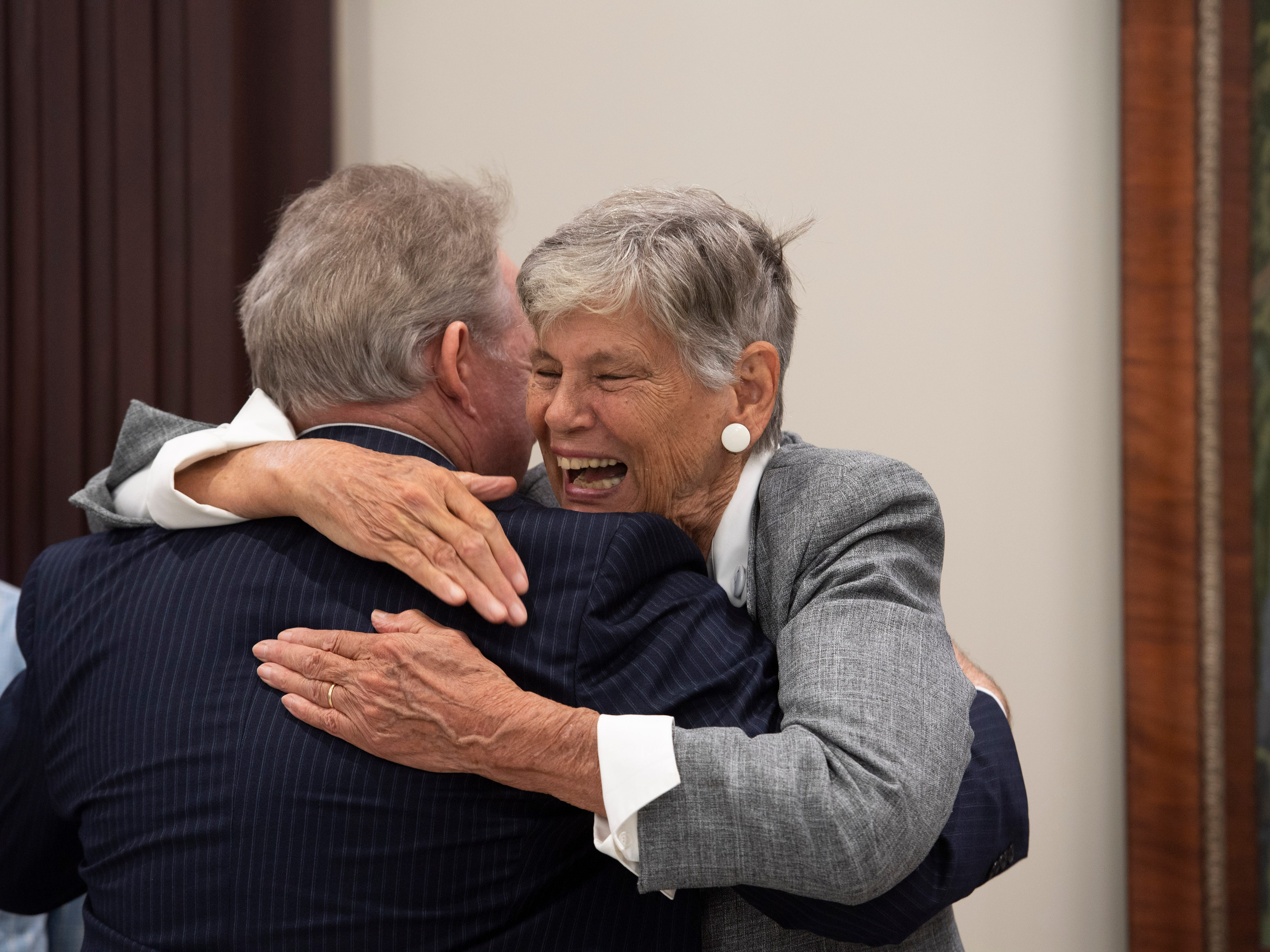 Martin County environmentalist and former commissioner Maggy Hurchalla embraces longtime friend John Milledge, of Fort Lauderdale, ahead of a hearing where Hurchalla appealed a Martin County jury's decision that she owes $4.4 million to rock quarry Lake Point for interfering in their contract with the county and the South Florida Water Management District on Tuesday, March 12, 2019, at the Fourth District Court of Appeal in West Palm Beach. Supporters of Hurchalla filled the courtroom as both sides made their case to three judges.