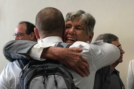 "Maggy Hurchalla, one of several environmentalists seeking the release of transcripts from a ""shade meeting"" of the South Florida Water Management District board, hugs a well-wisher Tuesday, March 19, 2019, outside a mock courtroom at Palm Beach Lakes Community High School."