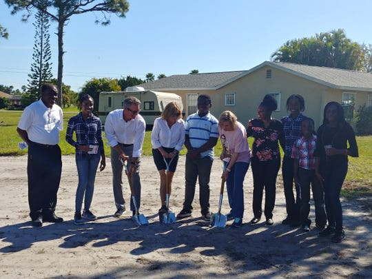Samuel and Mirnophta Moise, left, with Mike Wetzel, MaryJo Tierney, Fanuel Moise, Dana Trabulsy, and Jata,  Manoucheka, Kinsly and Samantha Moise break ground on the Women Build 2019 project on Southeast Faculty Court in Port St. Lucie.
