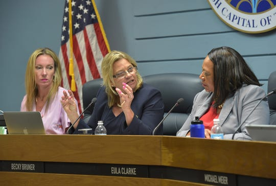 Stuart Mayor Becky Bruner (center) talks with Vice Mayor Eula Clarke (right), Commissioners Kelli Glass Leighton (left), Merritt Matheson and Mike Meier (both not pictured) as they discuss the future of the Sailfish Park ballfields during their regular commission meeting on Monday, March 11, 2019, in Stuart. The commission voted unanimously to rescind the request for proposal on the property, keeping the Sailfish Park ballfields intact.