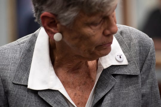 Buttons depicting Maggy Hurchalla on a kayak were distributed by supporters ahead of a hearing Tuesday, March 12, 2019, where Hurchalla appealed a Martin County jury's decision that she owes $4.4 million to rock quarry Lake Point for interfering in their contract with the county and the South Florida Water Management District at the Fourth District Court of Appeal in West Palm Beach.