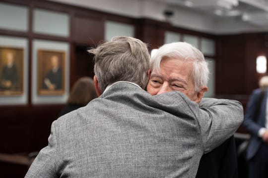 Martin County environmentalist Maggy Hurchalla hugs her appeals lawyer, Sandy D'Alemberte.