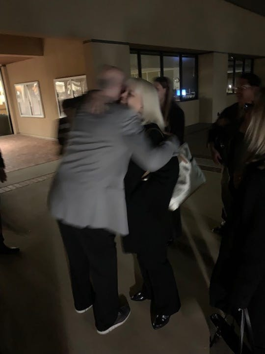Fred Bauermeister, left, executive director of the Free Clinic of Simi Valley, is congratulated by supporters Monday night after the Simi Valley City Council pledged $450,000 in community projects grant funds for the long-planned, one-stop home for the city's nonprofits, which the clinic is overseeing.