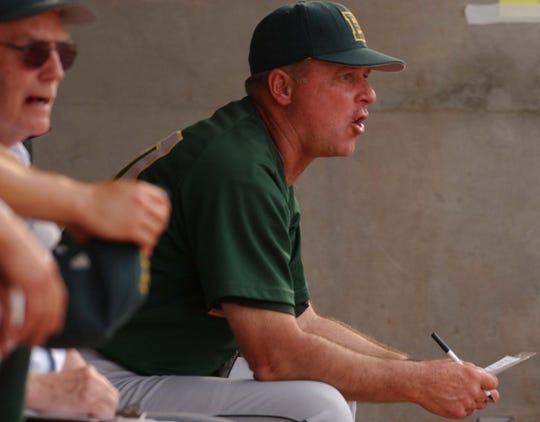 Mark Simon sitting in the dugout during a 2004 run into the state tournament.