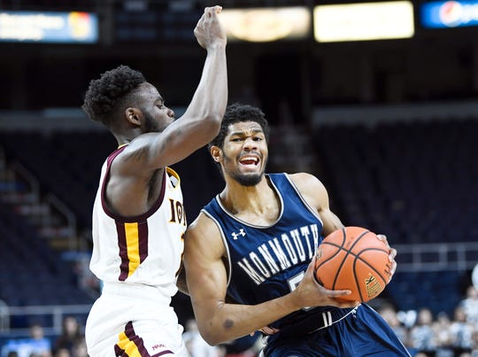 Iona guard Asante Gist, left, defends against Monmouth guard Nick Rutherford (5) during the first half of the championship NCAA college basketball game during the Metro Atlantic Athletic Conference tournament, Monday, March 11, 2019, in Albany, N.Y.