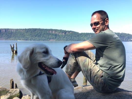 Yonkers resident Timofey Yuriev and his white golden retriever, Kira.