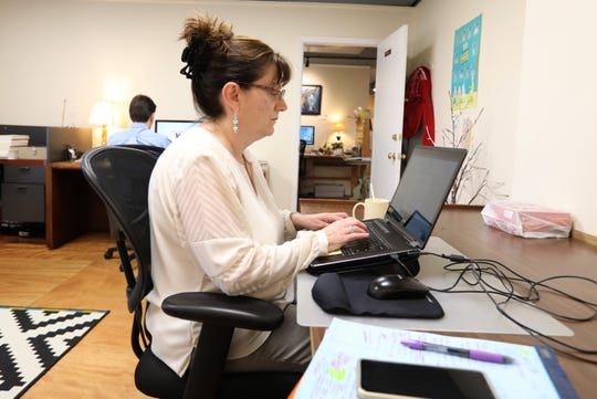 Lorraine Ash of Allendale, N.J. works at CILK119, a co-working place in Nanuet March 12, 2019.