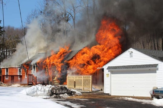 A fire gutted a house at the corner of Barrett Hill Road and Ernest Lane in the Mahopac Falls section of Carmel on March 11, 2019.