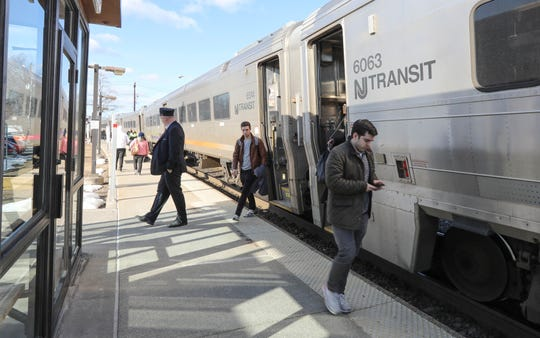 Passengers exit a NJ Transit train, March 12, 2019.