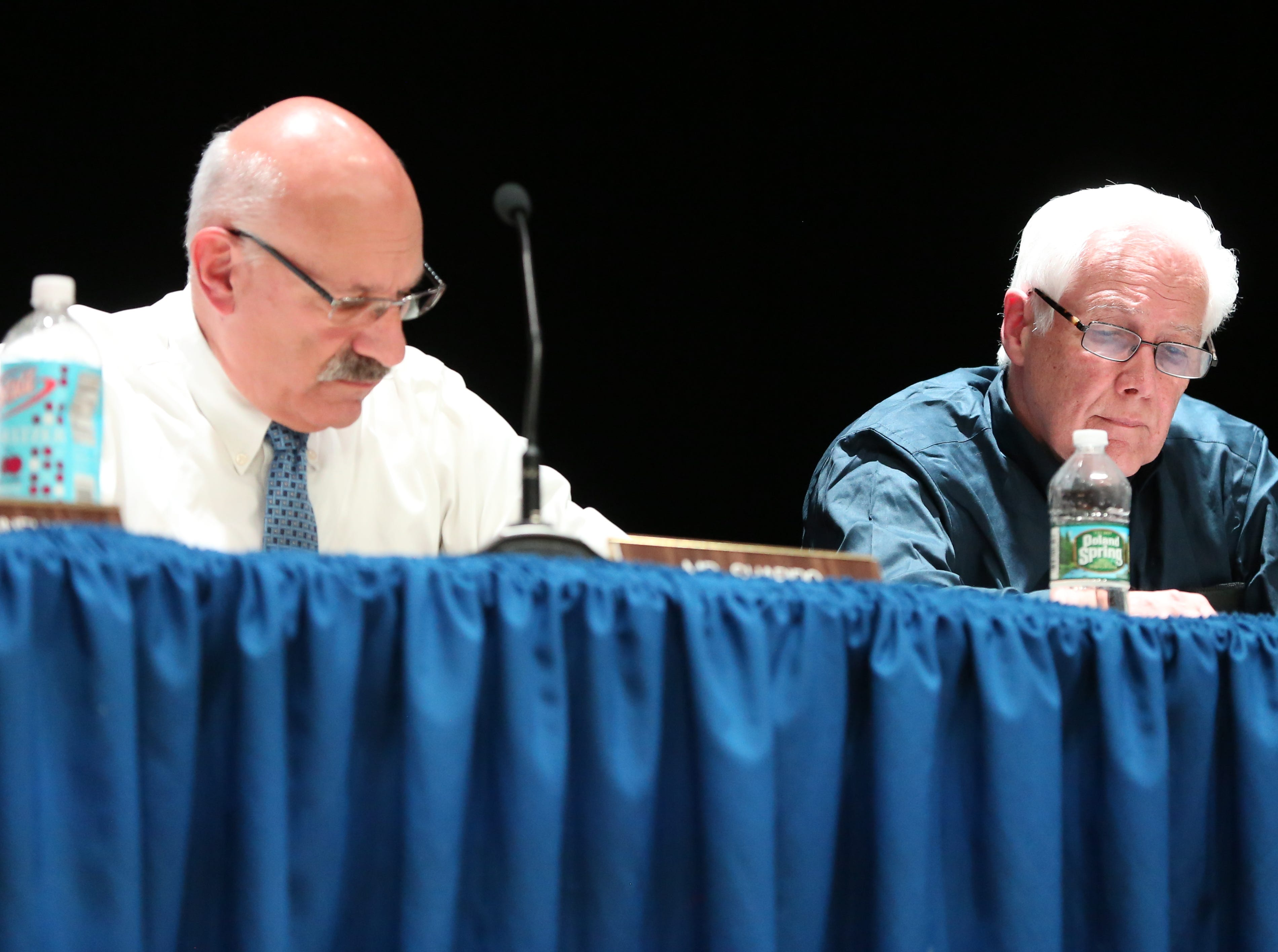 From left, Suffern Central School board members Paul Shapiro, and Donald Cairns make remarks during a special meeting to deal with backlash from the community over the board suspending veteran Superintendent Douglas Adams on undisclosed disciplinary charges at Suffern Middle School March 11, 2019.