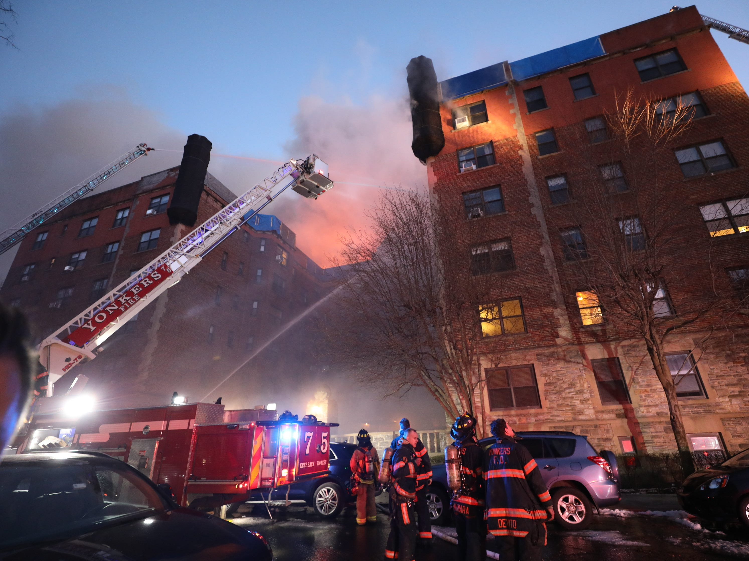 Yonkers firefighters battle a four-alarm fire at 15 Parkview Ave. in Yonkers.