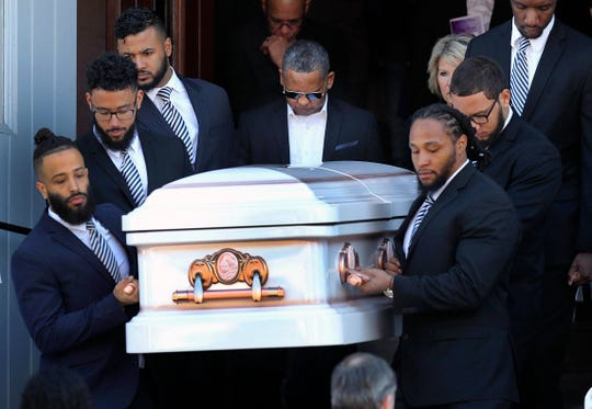 Pallbearers carry the casket of Jassy Correia, with her father, Joaquin Correira, center rear, following at the end of her funeral service at Saint Peter Parish, Saturday, March 9, 2019, in Dorchester, Mass. Jassy Correia was murdered after she left a Boston nightclub early the morning of Feb. 24. Her body was found in the trunk of a car in Delaware, several days later. (John Tlumacki/The Boston Globe via AP)