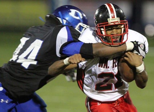 William Penn's Shareif Simpson is wrapped up by a Dover defender during a playoff game in high school in 2012. Simpson was killed in 2019 by his roommate.