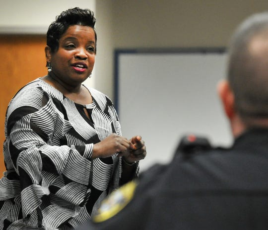 Public Affairs Specialist Janella Newsome of the Federal Bureau of Investigations speaks with local public information officers and media Tuesday morning about the FBI's policies on informing the public and media about the active investigations at the Wichita Falls Public Safety Training Center.