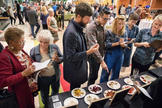 Attendees assess samples of cut and steamed beets during the Farm to Flavor dinner at UW's Discovery Building.