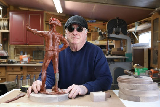 Charlie Leasure with a wax mould of a statuette soon to be cast in his foundry, Coopermill Bronze Works. After retiring as a dairy farmer, he opened with bronzeworks with Alan Cottrill, then added a woodworking shop.