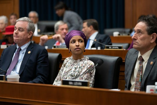 From left, Rep. David Trone, D-Md., Rep. Ilhan Omar, D-Minn., and Rep. Andy Levin, D-Mich., on March 6, 2019.