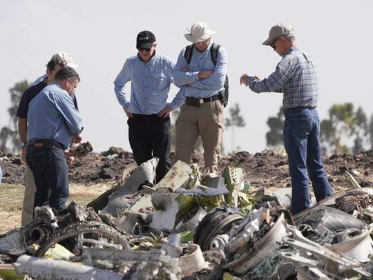 Investigators with the U.S. National Transportation and Safety Board look over debris at the crash site of Ethiopian Airlines Flight 302 on March 12, 2019, in Bishoftu.