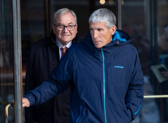 "William ""Rick"" Singer, CEO of Edge College & Career Network leaves the federal courthouse in Boston Tuesday. Singer pleaded guilty to racketeering conspiracy, money laundering conspiracy, conspiracy to defraud the US, and obstruction of justice in a case related to college admissions."