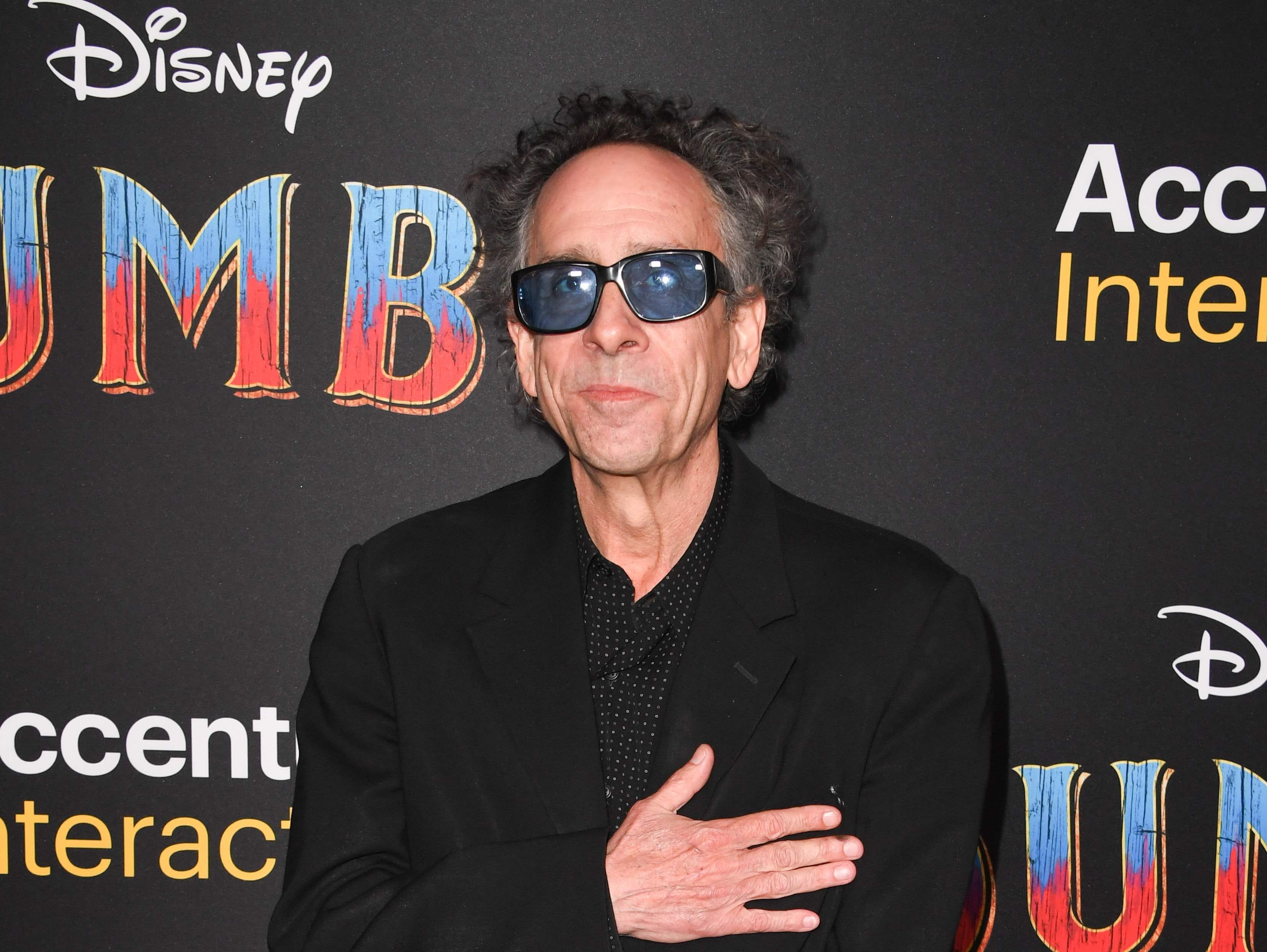 """US director Tim Burton arrives for the world premiere of Disney's """"Dumbo"""" at El Capitan theatre on March 11, 2019 in Hollywood. (Photo by Robyn Beck / AFP)ROBYN BECK/AFP/Getty Images ORG XMIT: Premiere ORIG FILE ID: AFP_1EI14P"""