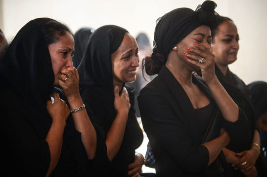 Women mourn during a memorial ceremony for the seven crew members who died in the Ethiopian Airlines accident at the Ethiopian Pilot Association Club in Addis Ababa, Ethiopia, on March 11, 2019.