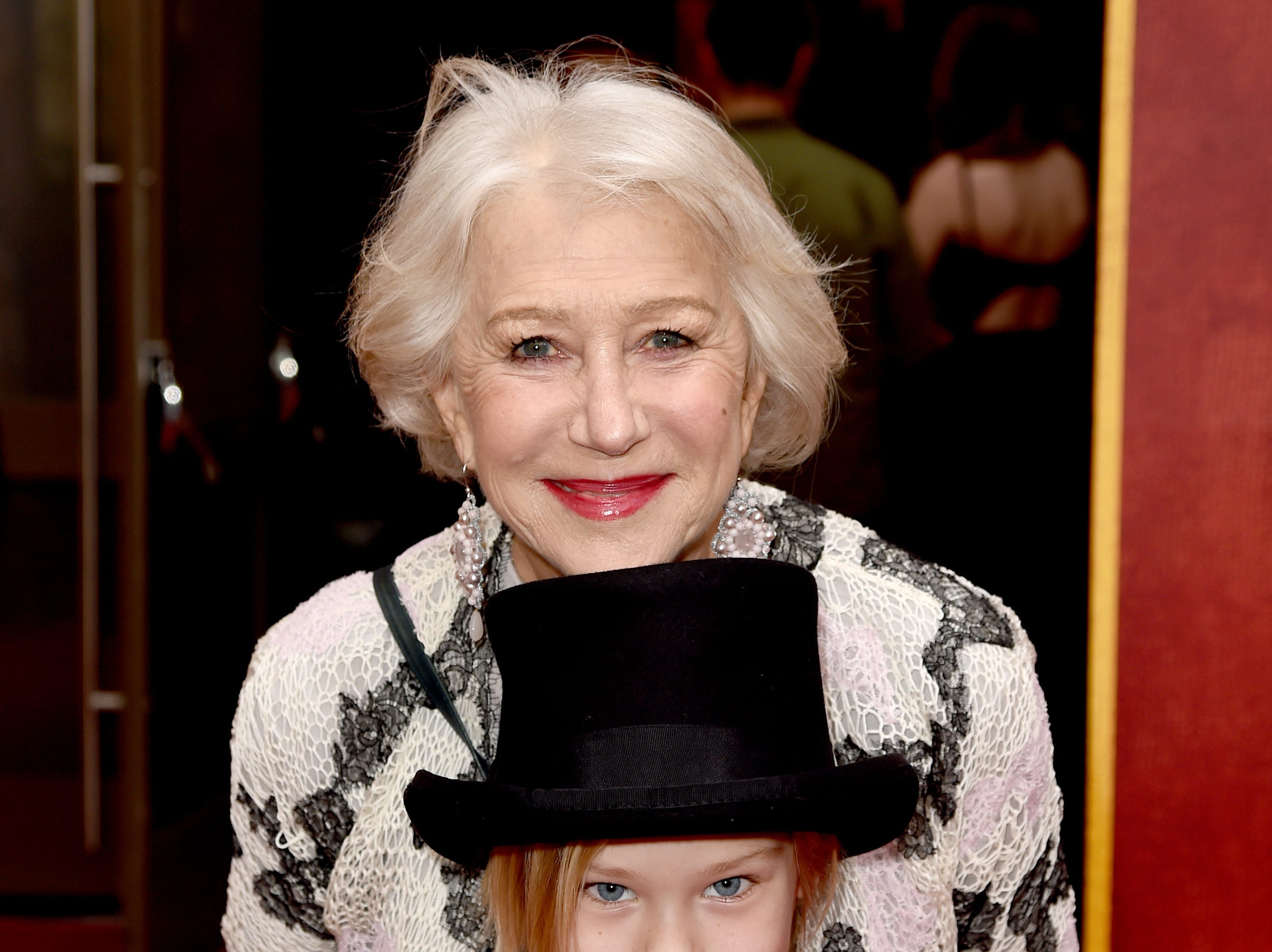 """LOS ANGELES, CALIFORNIA - MARCH 11: Helen Mirren and her grandchild attend the premiere of Disney's """"Dumbo"""" at El Capitan Theatre on March 11, 2019 in Los Angeles, California. (Photo by Kevin Winter/Getty Images) ORG XMIT: 775305574 ORIG FILE ID: 1135215218"""