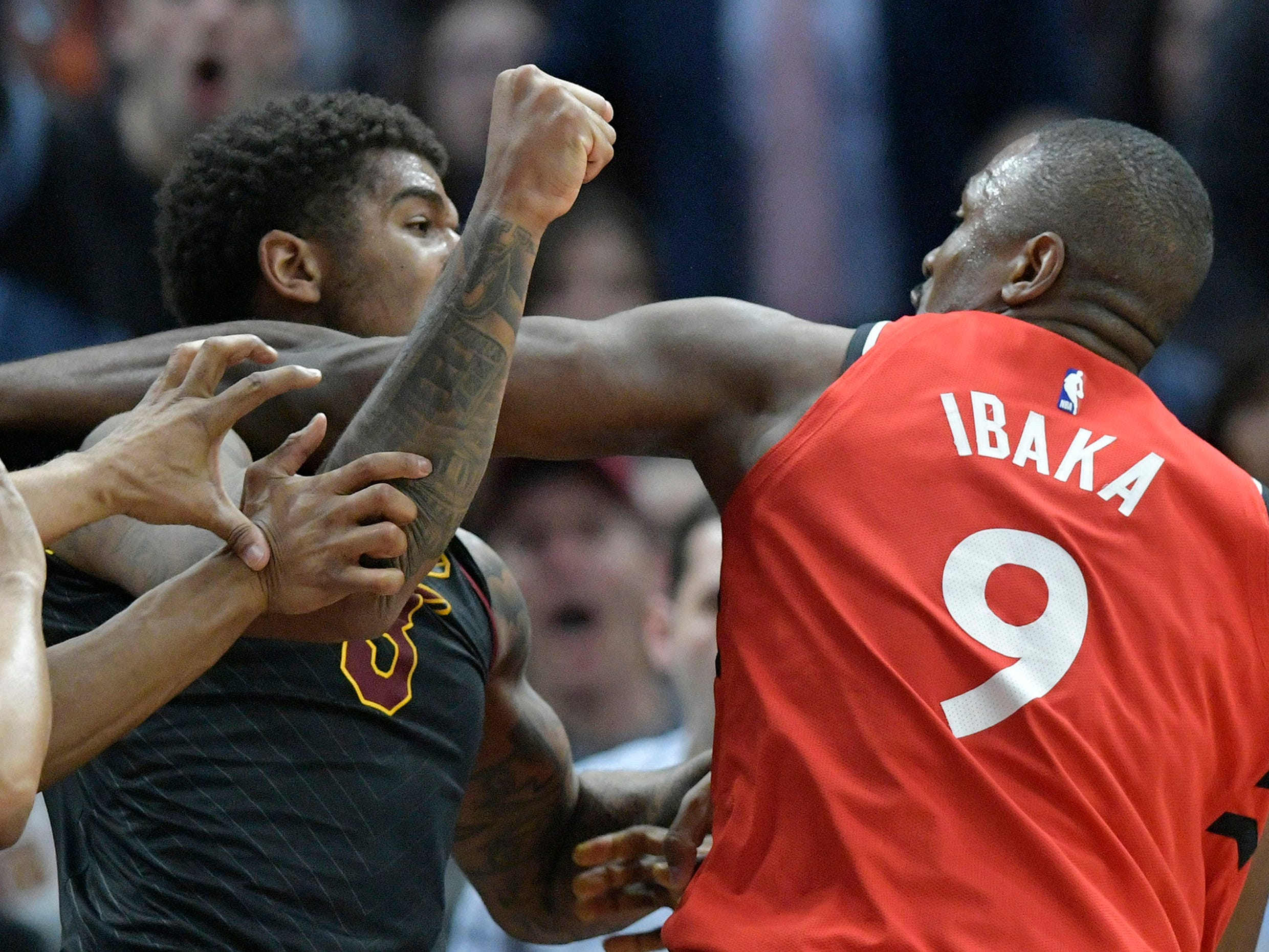 March 11: Cavaliers forward Marquese Chriss (3) and Raptors center Serge Ibaka (9) throw wild punches at each other during a third-quarter altercation in Cleveland.