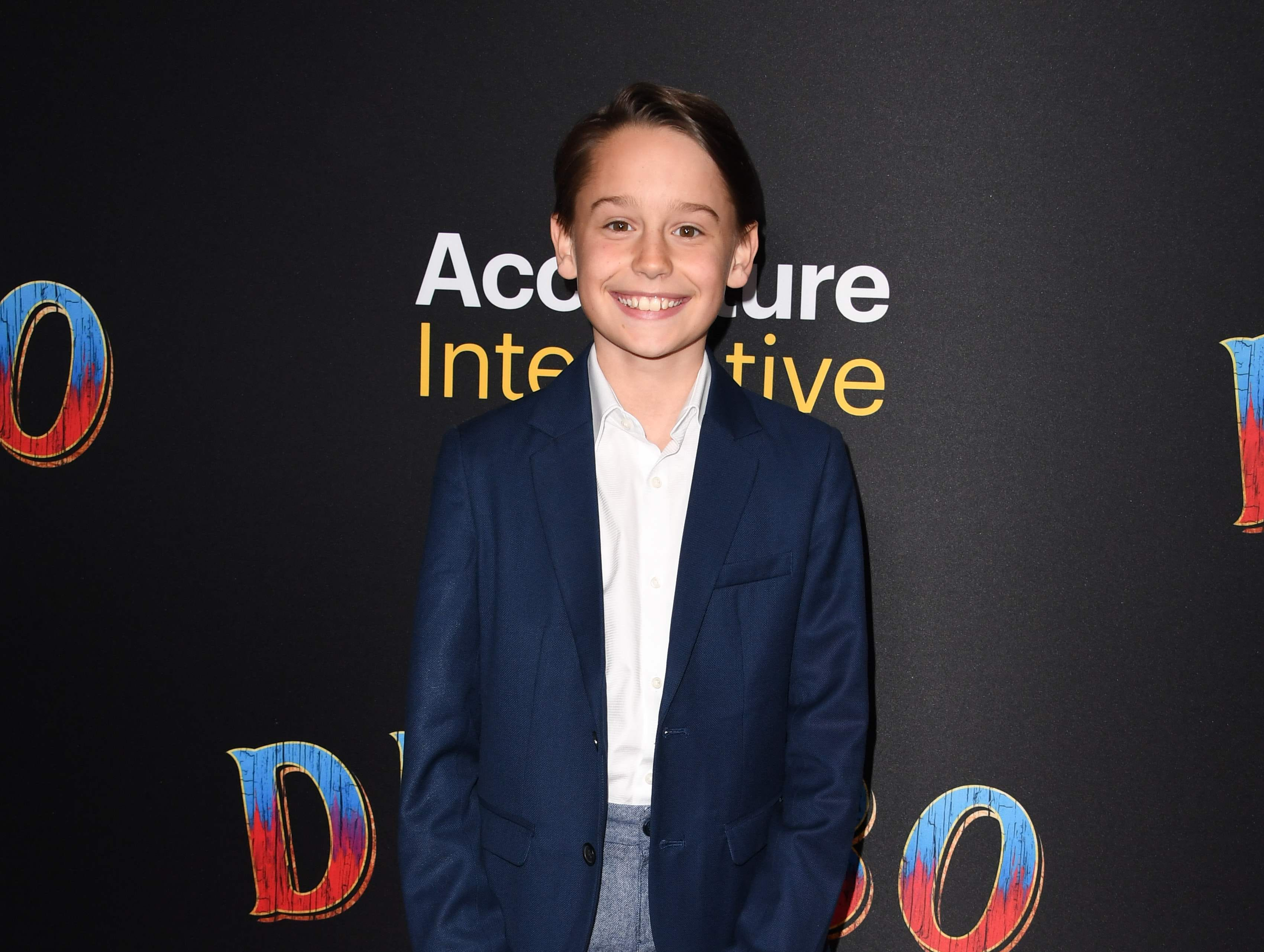 """US actor Finley Hobbins arrives for the world premiere of Disney's """"Dumbo"""" at El Capitan theatre on March 11, 2019 in Hollywood. (Photo by Robyn Beck / AFP)ROBYN BECK/AFP/Getty Images ORG XMIT: Premiere ORIG FILE ID: AFP_1EI2I6"""