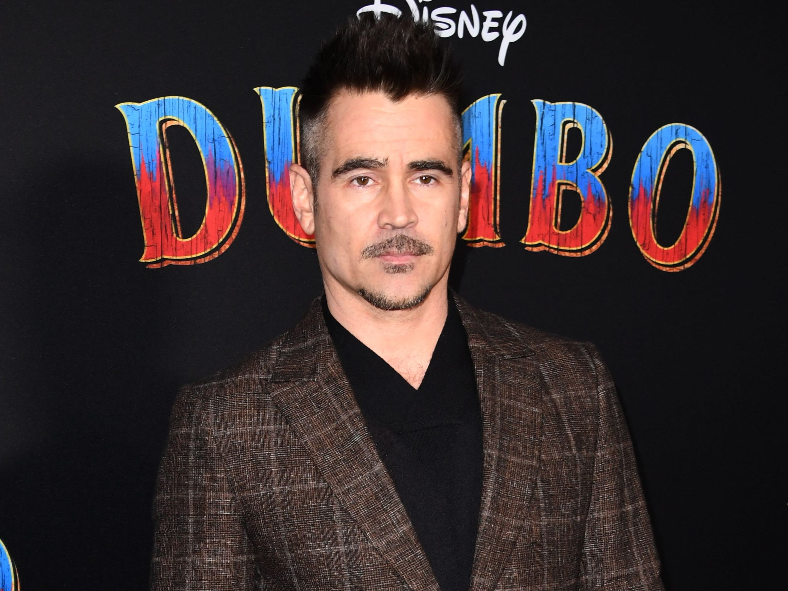 """Irish actor Colin Farrell arrives for the world premiere of Disney's """"Dumbo"""" at El Capitan theatre on March 11, 2019 in Hollywood. (Photo by Robyn Beck / AFP)ROBYN BECK/AFP/Getty Images ORG XMIT: Premiere ORIG FILE ID: AFP_1EI1U3"""