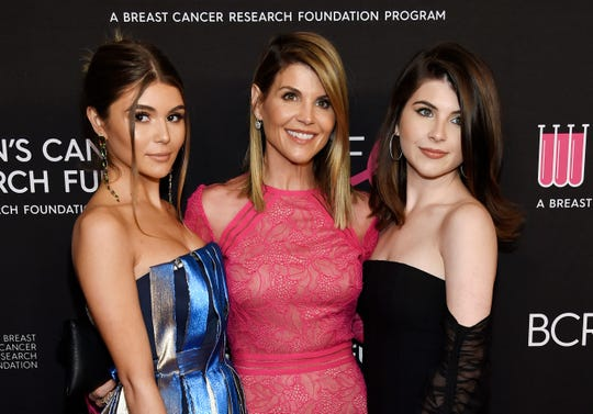 "Lori Loughlin, center, poses with daughters Olivia Jade Giannulli, left, and Isabella Rose Giannulli at the 2019 ""An Unforgettable Evening"" in Beverly Hills, Calif."