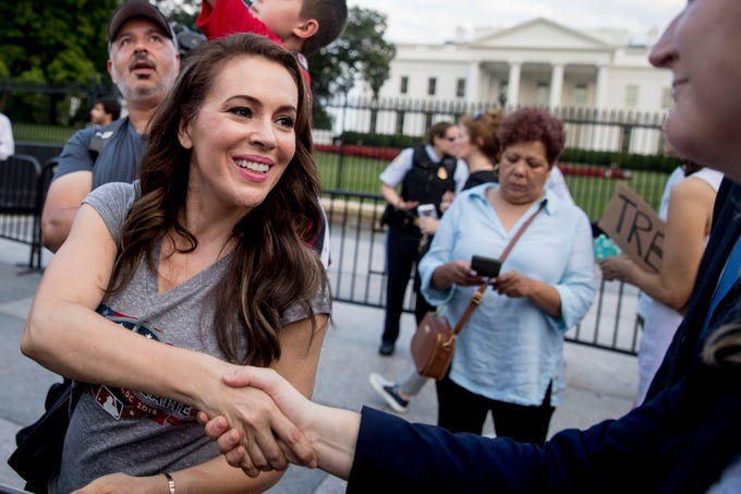 Actress Alyssa Milano arrives to speak at an protest outside the White House, Tuesday, July 17, 2018, in Washington. This is the second day in a row the group has held a protest following President Donald Trump's meetings with Russian President Vladimir Putin. (AP Photo/Andrew Harnik) ORG XMIT: DCAH128