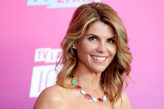 Lori Loughlin's involvement in the alleged bribe scandal for college admissions begins impacting her career.