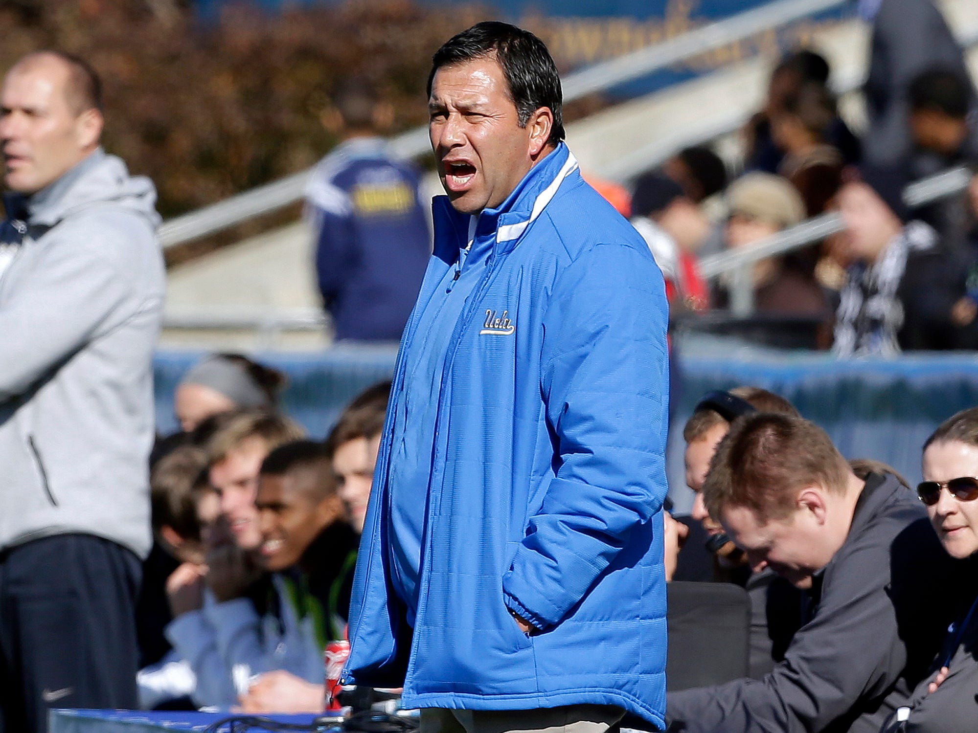 UCLA coach Jorge Salcedo reacts during the first half of an NCAA College Cup championship soccer game against Virginia in Cary, N.C. on Dec. 14, 2014. Salcedo was charged on March 12, 2019, in a scheme in which wealthy parents bribed college coaches and insiders at testing centers to get their children into some of the most elite schools in the country, federal prosecutors said. UCLA said that Salcedo has been placed on leave pending a review and will have no involvement with the team.